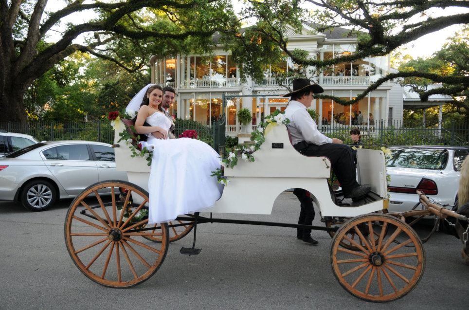 newly wed couple in a carriage