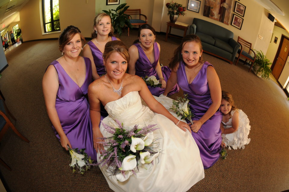 beautiful bride with her beautiful bride's maids and flower girl