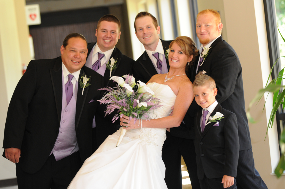 beautiful bride with the groom's men and ring bearer